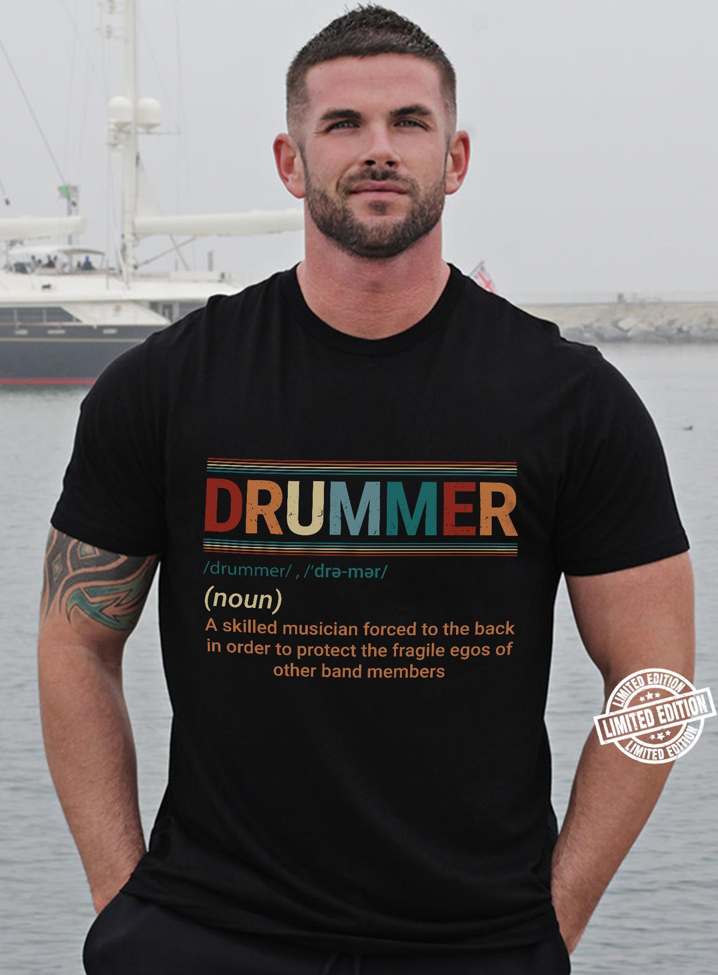 Drummer a skilled musician forced to the back in order to protect shirt